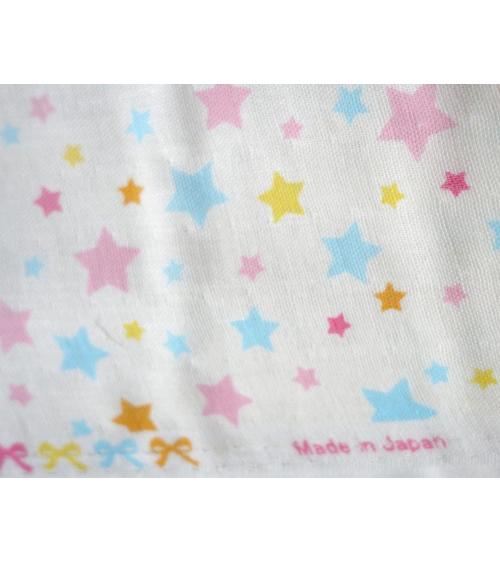 Tela japonesa. Estrellas de colores sobre fondo blanco
