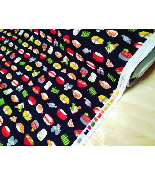Japanese fabric. Sushi over black