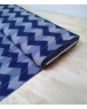 Zigzag pattern over an indigo blue