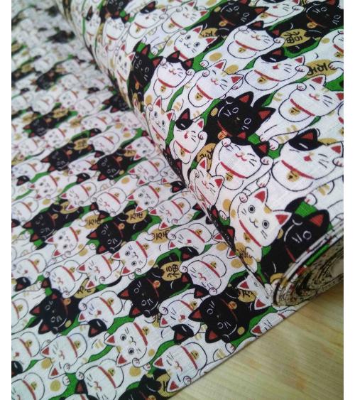 Japanese dobby fabric. Maneki neko over green