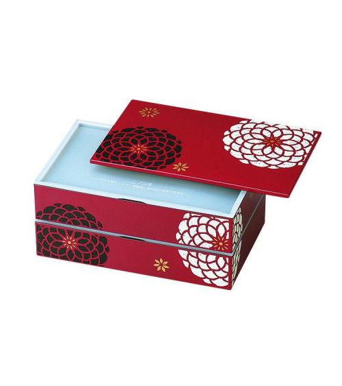 Bento box (lunch box) flores blancas y negras sobre fondo rojo