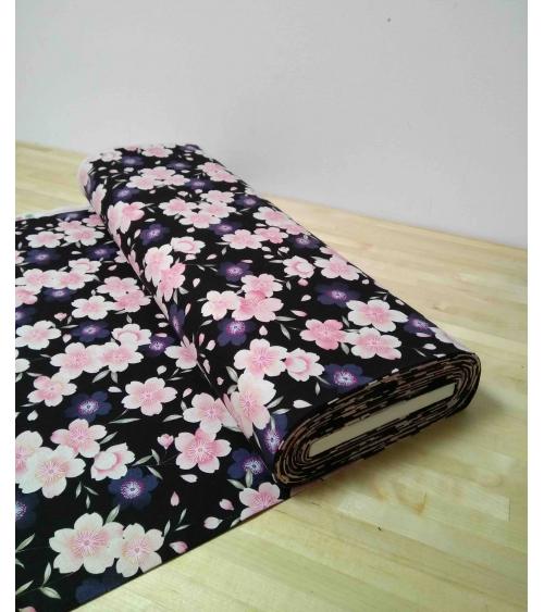 Loneta de sakuras sobre fondo negro