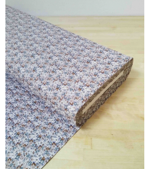 Embossed cotton fabric. Little flowers in muted colors.