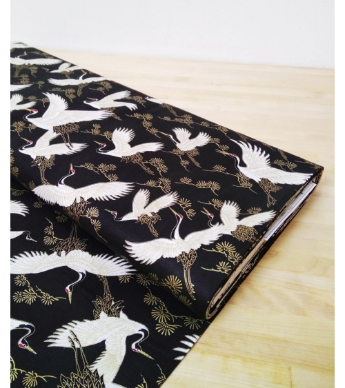Japanese fabric. Flying Cranes over black.