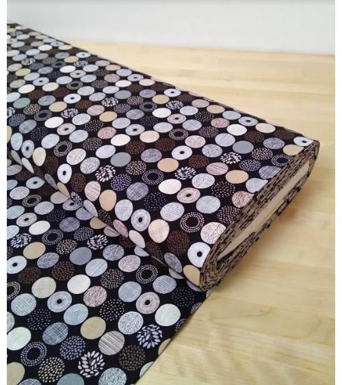 Japanese cotton fabric. Patterned circles over black.
