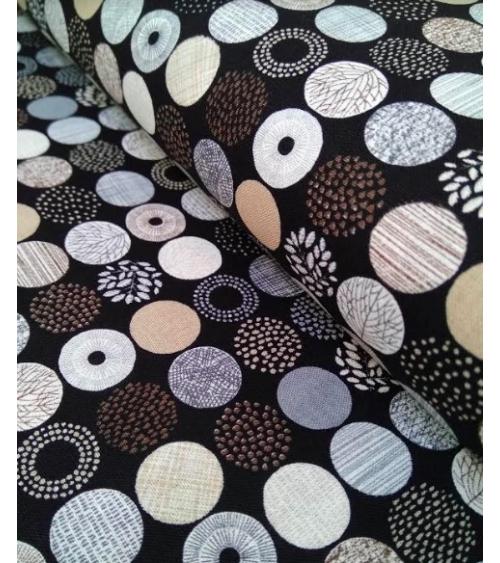 Tejido japonés con círculos en tonos neutros.