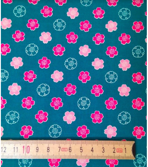 Japanese cotton fabric. Sakura flowers over blue