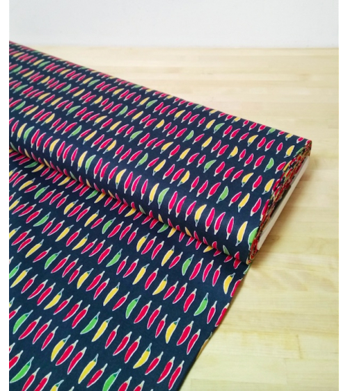 Japanese cotton fabric. Little chili peppers over indigo blue