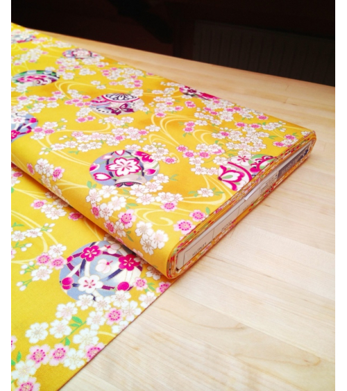 Japanese fabric. Sakura and temari over yellow.