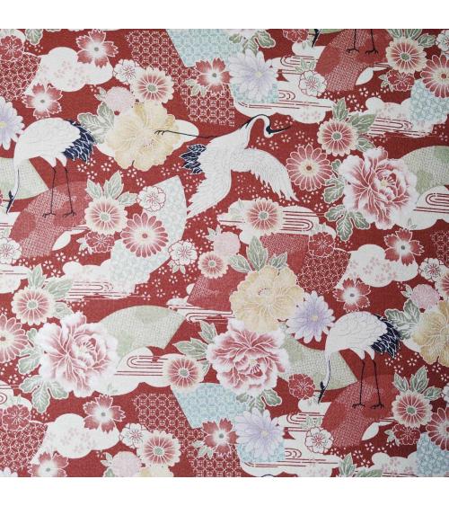 Tela Japonesa grullas y flores en rojo en crepe de algodón.