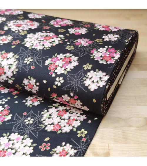 Japanese fabric with sakuras and asanoha on a black background.