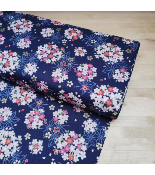 Japanese fabric with sakuras and asanoha on a blue background.