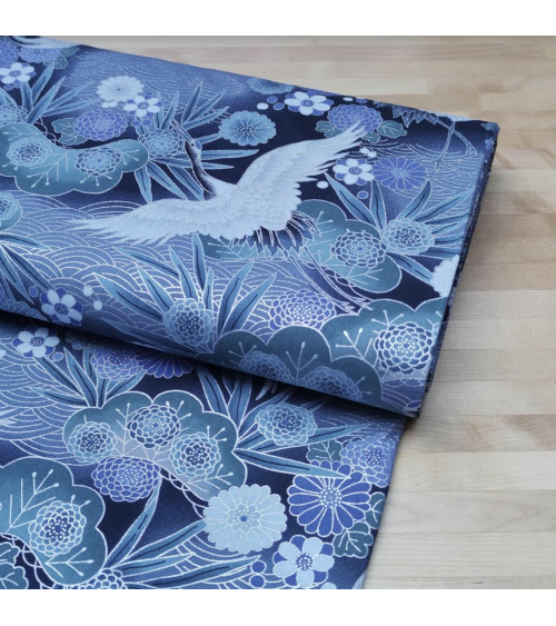 Japanese cotton fabric of cranes with silver details.