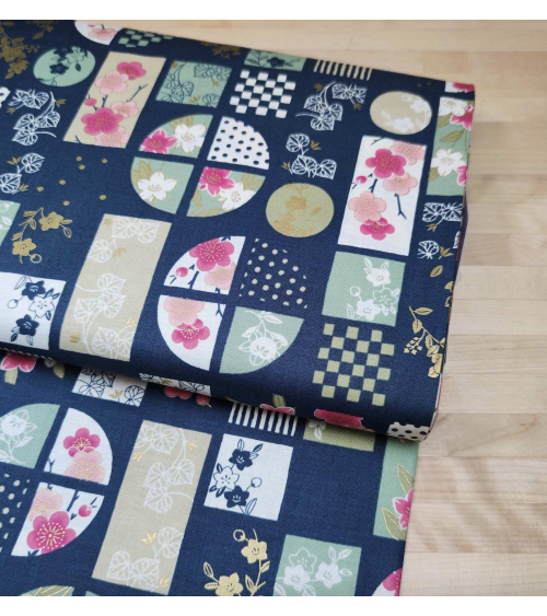 """Japanese fabric """"windows"""" in teal blue."""
