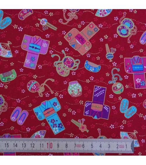 Los simpáticos kimonos sobre fondo rojo