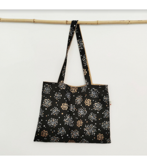 Reversible tote bag 'Golden bouquets' in black and mustard yellow.