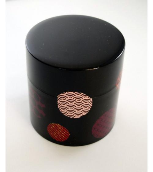 Bote para té con círculos con motivos japoneses y fondo negro