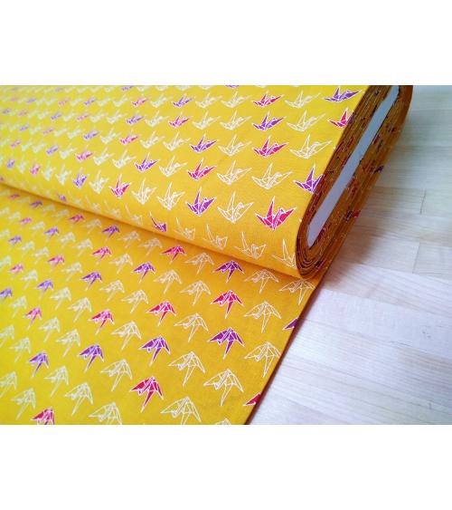 Japanese tsuru (cranes) over mustard yellow