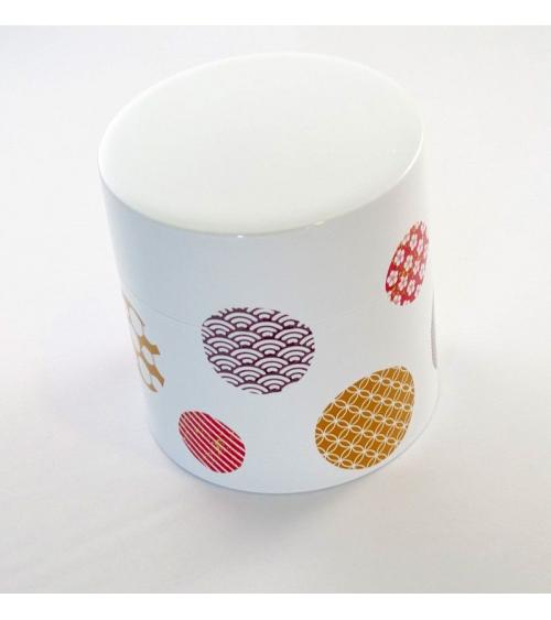 Bote para té con círculos con motivos japoneses y fondo blanco