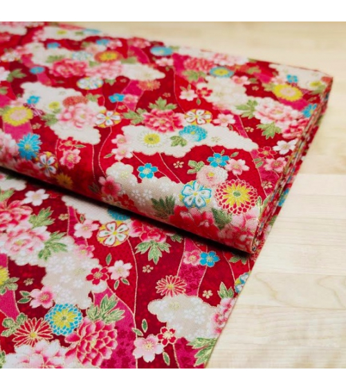 Japanese fabric. Flowers and clouds over red.
