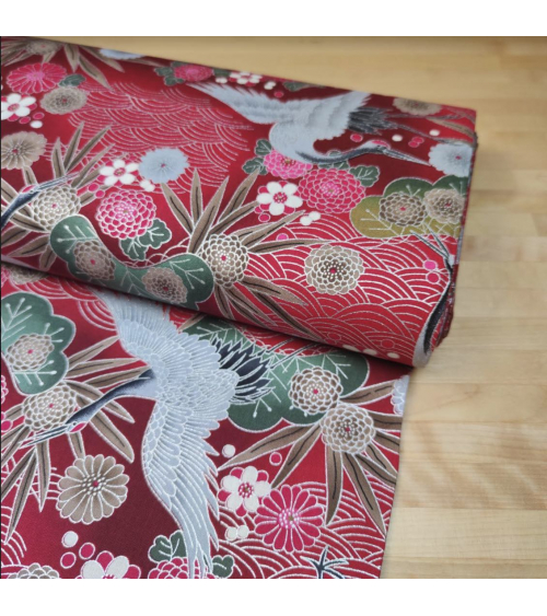Japanese cotton fabric of cranes in red with silver details.