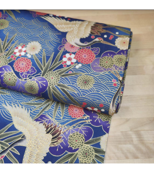 Japanese cotton fabric of cranes in blue with golden details.