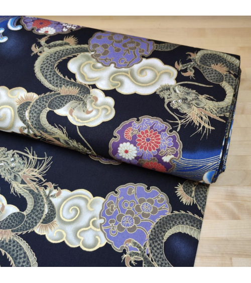 Japanese cotton fabric of dragons, clouds and waves over black.