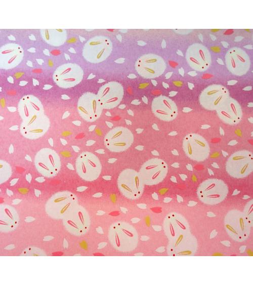 Papel japonés chiyogami tiernos conejitos sobre fondo en rosas