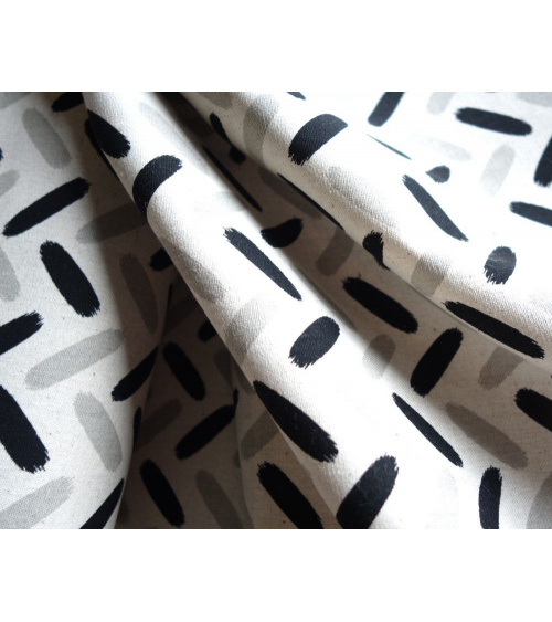 Trazos en espiga gris y negro sobre crudo