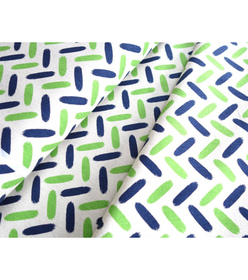 Trazos en espiga verde manzana y azul ultramar sobre crudo