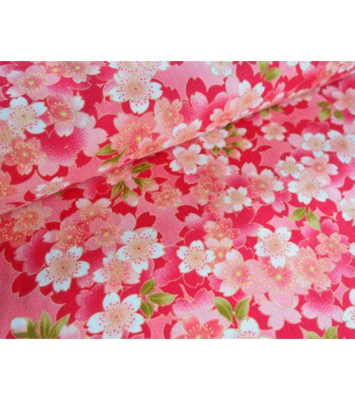 Tela ligera de sakuras sobre fondo rosa